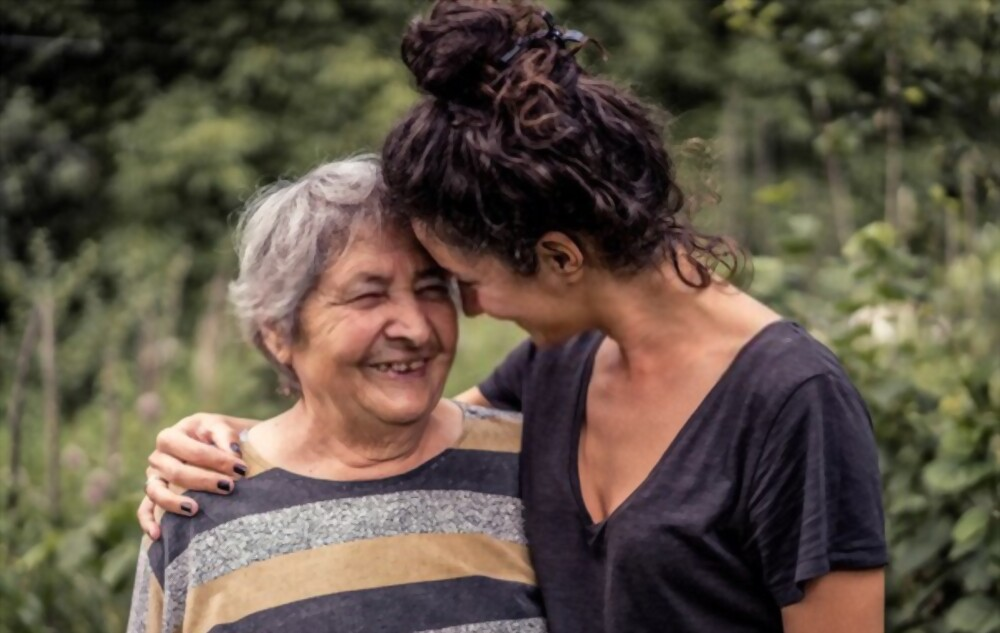 home carer happy with old women