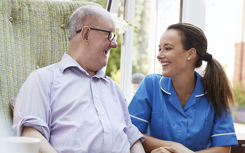 care assistant heling elderly happy faces